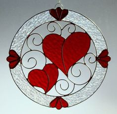 This handmade stained glass, wreath suncatcher is the perfect gift for that special someone, a wedding, or Valentines Day. It is made with the