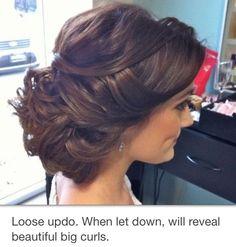 Brunette pin up elegant curls down
