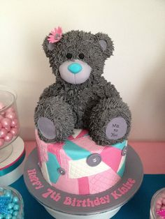 Tatty Teddy Bear cake - This was for my daughters birthday. The bear is made from rice krispy treats and decorated with fondant and piped royal icing. the Base cake is chocolate sponge with chocolate mousse and fresh raspberry filling. I also made matching cake pops, cookies and cupcakes.