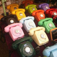 Colored rotary phones. At flea market in São Paulo, remind me of Glitterfarm coloured crates!