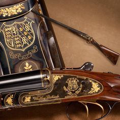 Lady Diana's Royal Wedding 1981 Westley Richards side-by-side shotgun - Made for the July 29, 1981 nuptials of Lady Diana Spencer and HRH Prince Charles, this Westley Richards side-by-side 12 gauge was engraved by the Brown Brothers with gold crests and floral accents. The British royal seal and other heraldic emblems of the couple are included in the decoration. At the NRA National Firearms Museum in Fairfax, VA