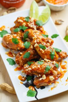 Crispy Baked Peanut Sweet Chili Chicken Wings by Closet Cooking. Crispy baked chicken wings in a peanut sweet chili sauce that are finger licking good!