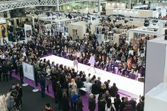 Two models cross paths going up and down the runway at the Spirit Stage stage and catwalk. Watched by a beyond-capacity audience, with most having to stand, the models showcase the womenswear fashion apparel and accessories on offer in the collections featured by brands and designers exhibiting at Pure London AW17/18 Olympia London, Fashion Show, Fashion Outfits, Aw17, Exclusive Collection, Catwalk, Paths, February, Stage