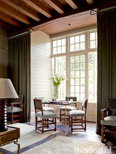The homeowner's Jonathan game table is surrounded by antique English chairs.