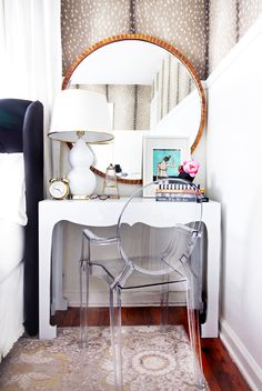 Feminine vanity with lucite chair and round mirror