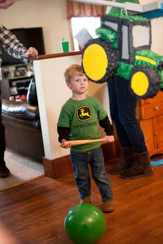 Tractor Party (Chickabug): Cute 3-year-old party that was all about John Deere tractors; included balloons for play, a pinata, a tractor pulling fruit, green and yellow candy, John Deere cookies in a jar and more!