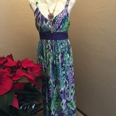Boutique Maxi Dress Beautiful purple and greens and the silky drape of this Maxi have drawn many compliments. Worn once by my young daughter to a church Women's Tea, but is designed as a women's dress. This would be stunning with the right heels or even sandals. Perfect condition. I have Swarovski grape cluster earrings that match perfectly if interested. Studio West Apparel Dresses Maxi