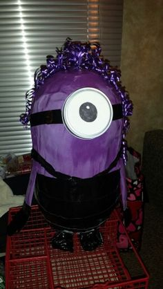 Purple Minion Piñata created for my son's 8th birthday party! Created using 2 balloons smashed together and taped together with masking tape. Spray painted and duct tape outfit and wide mouth canning jar ring goggle with curling ribbon crazy hair. Easy Peasy!