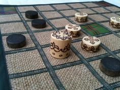 Brandubh - the ancient Irish board game for 2 players. Tartan, Sack cloth, Woollen, Hessian, Pine, Wood, Pyrography, Ribbon, wax, Natural