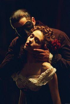 Gerard Butler and Emmy Rossum in a promotional still for The Phantom of the Opera
