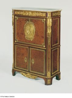Secretaire Jean-Henri Riesener (1734 - 1806) France 1783 Oak, veneered with thuya-wood, amaranth, sycamore, stringings of ebony and box, Carrara marble, gilt bronze and brass