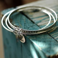A set of stacking bangle bracelets customized for mom. EcoFriendly sterling silver that is hand stamped with names of your children.    Perfect for