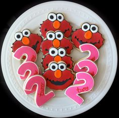 Decorated Custom Elmo and Pink Number Cookies, Perfect for your Girl's Birthday Party.