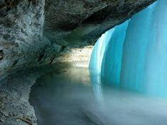Behind frozen waterfall