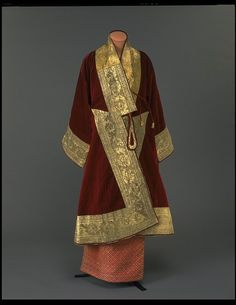 Items of dress of a Burmese minister. Konbaung Dynasty (1752-1885). Consisting of a court costume of red velvet and gold and a white muslin jacket and headband. ca. 1850 to 1885.
