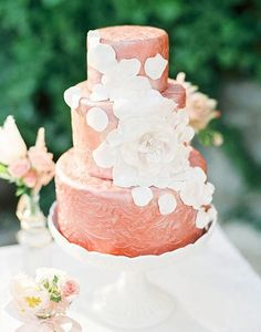 98. This shiny and gorgeous rose gold wedding cake came straight from the most darling wedding inspiration in Austria, captured by Peaches & Mint Photography with cake by Cake Away.