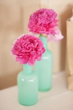 mint vases with fuchsia flowers http://www.weddingchicks.com/2013/10/04/wedding-in-turquoise-and-pink/