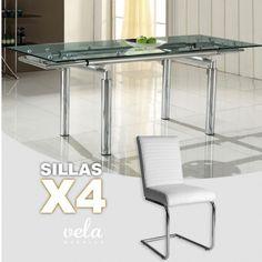 """Conjunto  de mesa para comedor extensible en cristal transparente y sillas con estructura en forma de """"C""""."""