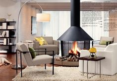 Cozy living room with a great fireplace in the center. Perfect for winter. #homedecor #design