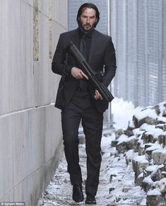 Keanu Reeves uses cars for cover as he films John Wick