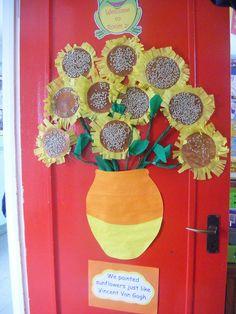 Classroom door: April showers bring May flowers, students names on each flower, rain on top, flowers below