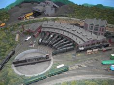 Most real roundhouses had in/out tracks,with a service facility on the in track for water/sand/fuel. Description from forum.atlasrr.com. I searched for this on bing.com/images