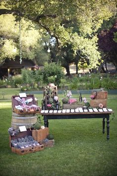 Display Idea for craft fair or farmers' market. Like the barrel and use of suitcase to display product on the ground