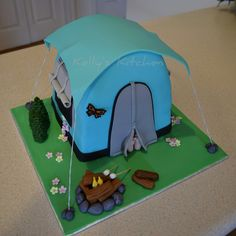 Camping Themed Birthday Cake I am a bit behind in posting cakes. I made this tent one back in April for a camping themed party. I wasn'...