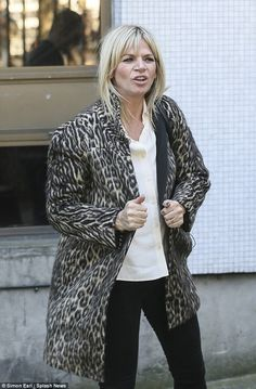 Caught in the act: Zoe Ball has allegedly been spotted kissing a 22-year-old boyband membe...