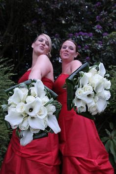 Calla lily and rose bridesmaids flowers. Hate the black ribbons though :/