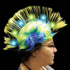 Let's get down and have fun tonight. Our fabulous funky and super colorful light up mohawk wigs comes with 6 high powered LED's for night time fun and also make an eye catching costume topper for daytime events, too! Dress for Mardi Gras, decade theme parties or anytime funky fits your theme. Our brightly colored light up mohawk LED adorned wig come with 3 AG13 batteries included and installed and can be replaced. One size fits most. Sold by the wig.