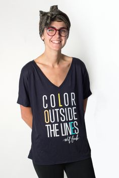 "Shipping will take 2-5 business days on this item.Pre-orders will take 6-10 days. Because you don't have to be a kid to Color Outside the Lines. Flaunt this tee and share your creativity, you go-getter.Jo is 5'8"" and is wearing a size M.UnisexMidnight Loose TeeWhite, orange, yellow and blue ink65% Polyester32% Cotton3% ViscoseAll proceeds benefit Art Feeds. Art Feeds does not accept cancellations, returns or exchanges."