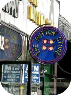 The Button Store in LA has a giant fabulous neon button as a sign.