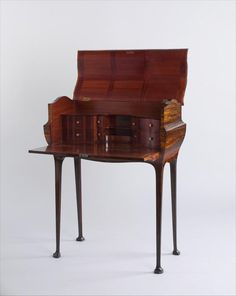 English 19th c. Mahogany and Ebony Desk. This lovely little desk was made by the Mervyn Macartney Factory for display during the London Arts and Crafts Exhibition in 1893.