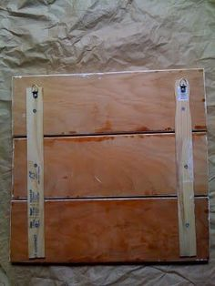 Use paint stirrers to attach wood planks from a pallet and make headboard as large and wide as you want it.  Then paint it and stencil words on it, hand just above your pillows