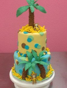 Layered Cake with Monkey and Palm Tree on Top. Tutorial shows you how to make the palm tree using modeling chocolate.