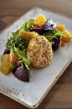 Heirloom beet salad with warm goat cheese, local greens, hazelnut vinaigrette from Cedar + Stone at the JW Marriott Minneapolis Mall of America
