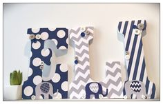 A personal favorite from my Etsy shop https://www.etsy.com/listing/475161586/navy-and-gray-elephant-nursery-grey-wood