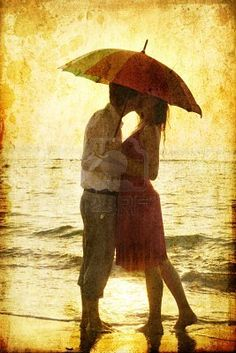 Image detail for -Stock Photo - Couple kissing under umbrella at the beach in sunset ...