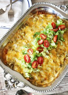 A recipe for stacked green chile chicken enchiladas made in the New Mexico style. Recipe for green chile sauce included. Made in a casserole dish, these green chile chicken enchiladas as perfect for feeding a crowd! Chicken Enchilada Casserole, Enchilada Recipes, Chicken Enchiladas, Taco Casserole, Green Chili Enchiladas, Mexican Enchiladas, Enchilada Bake, Mexican Dishes, Mexican Food Recipes