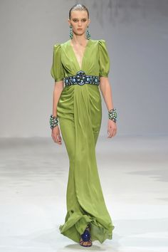 Andrew Gn green gown with turquoise jewelry cuffs, belt, earrings