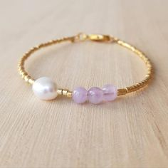 * Small lavender amethyst semi-precious gemstone beads (4 mm) * Ivory white baroque freshwater pearl (width 6-7 mm) * Tiny (1.6 mm!!!) Japanese Miyuki Delica glass seed beads in galvanized gold * 18k gold-filled lobster clasp (1.2x0.7 cm) and gold-plated findings   * Wrist in photos is 17 cm/6.7 * Amethyst Bracelet, Pearl Bracelet, Amethyst Jewelry, Amethyst Crystal, Minimalist Jewelry, Minimalist Style, Gemstone Beads, Seed Beads, Crystal Bracelets