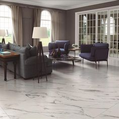 Hera white marble effect tiles offer a opulent option for stylish floor tile designs in living rooms, open plan family areas and bathrooms. These large tiles are hardwearing porcelain tiles and are ideal for beautiful, stylish homes. The PEI4 rating means they can also be used in certain commercial environments.