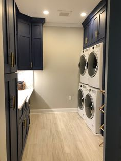 Blue cabinets, gold hardware, double washer dryer, porcelain wood grain tile planks, silestone counter Mudroom Laundry Room, Laundry Decor, Laundry Room Remodel, Laundry Room Organization, Laundry Room Design, Wood Grain Tile, Build My Own House, Modern Laundry Rooms, Blue Cabinets