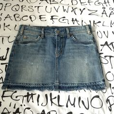 """Distressed Denim Mini Citizens of Humanity mini with awesome back pocket detail. 13"""" length. Super cute and like new. Citizens of Humanity Skirts Mini"""