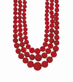 Three multi-strand coral necklaces