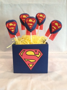 Superman cake pops. Check out Desserts on Delicious on Facebook.