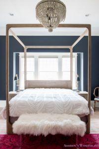 master-bedroom-black-walls-white-wood-bead-chandelier-whitewashed-hardwood-flooring-four-poster-bed-restpration-hardware-inkwell-rug-14-of-19