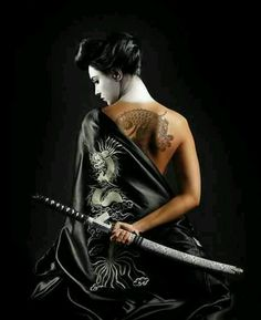 Silence carries it's own strength ~ Asian woman japanese woman with sword