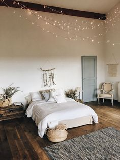 Love the wood colors and lights. Also the exposed beam is nice and the door color is pretty.